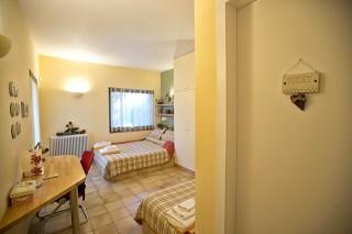 villa christina single beds room
